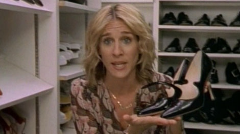 �Sex and the City�s� Carrie Bradshaw holds up a pair of coveted Manolo Blahnik high heels.