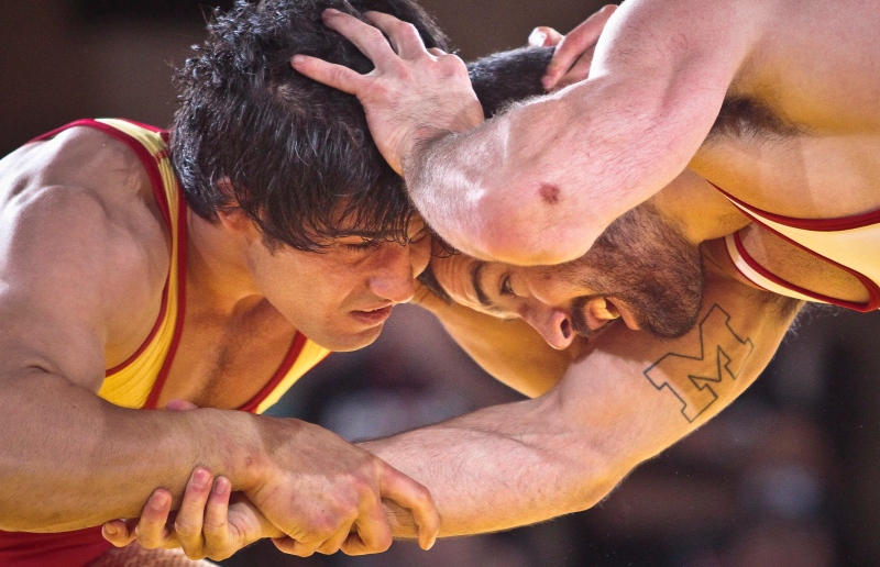 Freestyle wrestlers Mehdi Taghavi Kermani, left, and Kellen Russell compete at an international wrestling exhibition in this May 2013 file photo. (AP Photo/Bebeto Matthews)