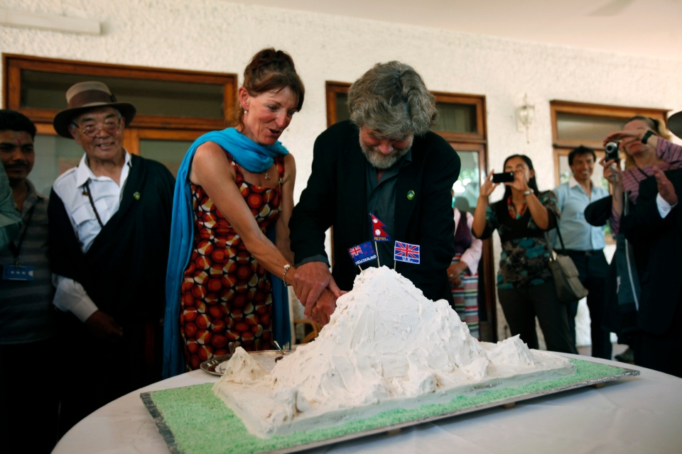 New Zealand climber Lydia Bradey, third from left and Italian Reinhold Messner, cut an Everest shaped cake at a function to mark the 60th anniversary of the conquest of Mount Everest at the British Embassy, in Katmandu, Nepal, Wednesday, May 29, 2013. (AP / Niranjan Shrestha)
