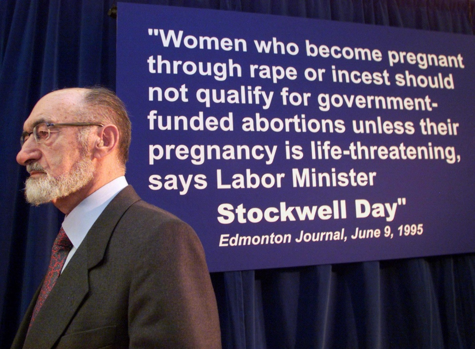 Abortion rights advocate Dr. Henry Morgentaler stands next to a sign quoting Canadian Alliance leader Stockwell Day during a news conference in Toronto Tuesday November 21, 2000. (Kevin Frayer / THE CANADIAN PRESS)