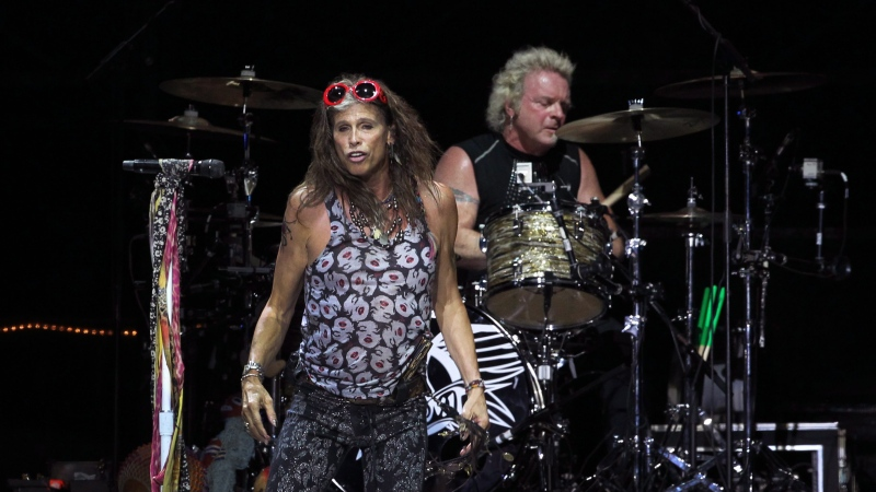 Lead singer of American rock band Steven Tyler, front, of is seen with drummer Joey Kramer of Aerosmith perform on Saturday, May 25, 2013 in Singapore during the inaugural Social Star Awards concert.(AP Photo/Wong Maye-E)