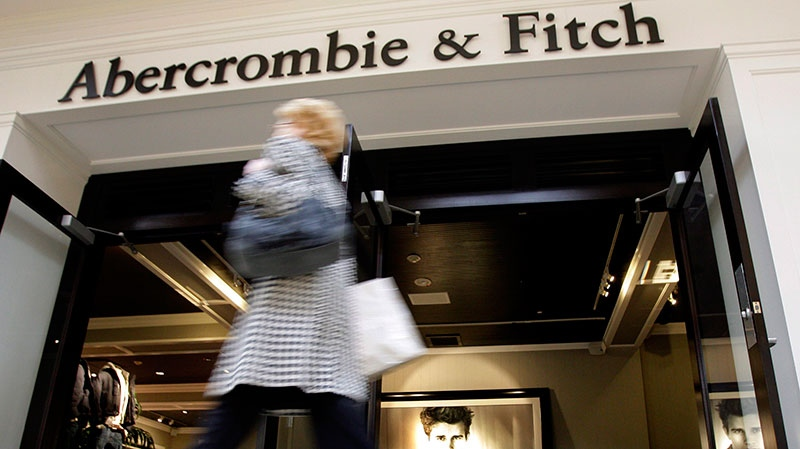 A shopper hurries past the Abercrombie & Fitch store at Beachwood Place Mall in Beachwood, Ohio, Thursday, Dec. 4, 2008. (AP / Amy Sancetta)