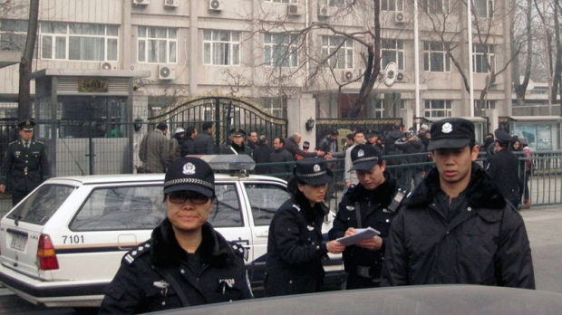 Chinese police officers stand watch in Beijing, China, Tuesday, Feb. 22, 2011. (AP / Gillian Wong)