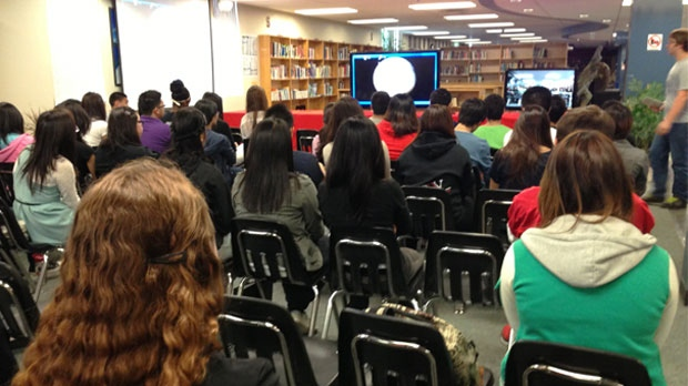 Seventy students in at Sisler High School watch a live procedure on May 30, 2013.
