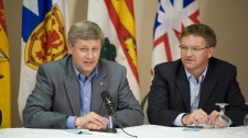 Prime Minister Stephen Harper addresses the Conservative Atlantic Caucus in Fredericton at the Riverside Resort on Thursday August 14, 2008. At right is Fabian Manning. (THE CANADIAN PRESS/David Smith)
