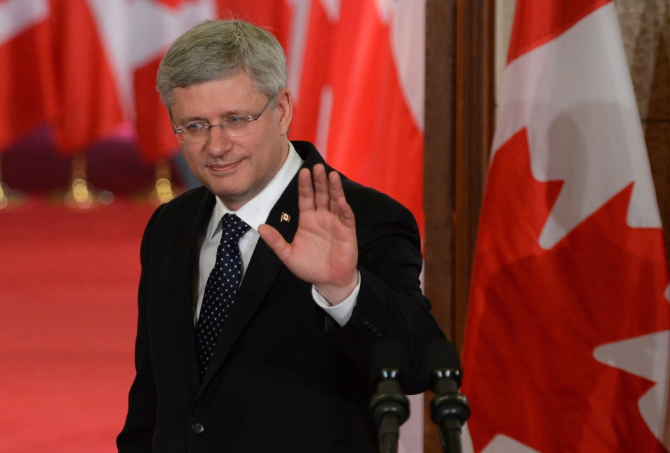 Prime Minister Stephen Harper waves as he leaves a press conference on Parliament Hill in Ottawa on Thursday, May 30, 2013. (The Canadian Press/Sean Kilpatrick)