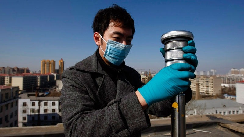 A worker examines a device used to test the air for radiation at a monitoring station in Harbin in northeast China's Heilongjiang province Tuesday March 29, 2011. (AP Photo)