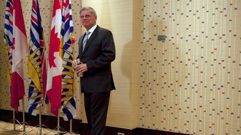 John Cummins pauses for a moment after announcing his bid to become the new leader of the B.C. Conservative Party during a news conference in Vancouver, B.C. Tuesday, March 29, 2011. THE CANADIAN PRESS/Jonathan Hayward
