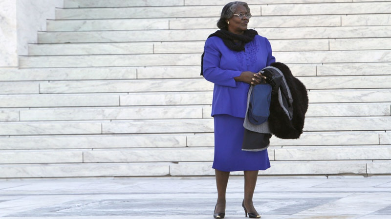 Plaintiff Betty Dukes stands outside the Supreme Court in Washington, Tuesday, March 29, 2011, prior to attending a case of women employees against Wal-Mart. (AP Photo/Jacquelyn Martin)