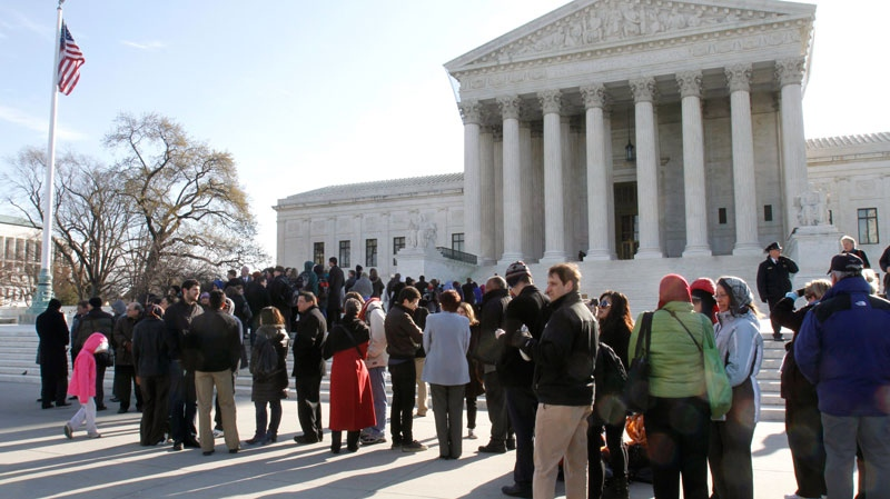 People line up outside the Supreme Court in Washington, Tuesday, March 29, 2011, to attend a hearing on women employees against Wal-Mart. (AP / Jacquelyn Martin)