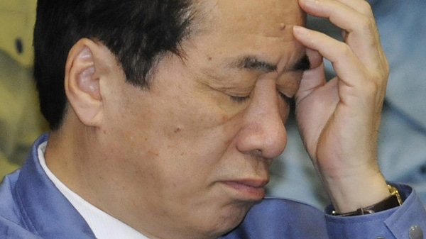 Japan's Prime Minister Naoto Kan reacts during the Upper House Budget Committee in Tokyo Tuesday, March 29, 2011. (AP Photo/Kyodo News)