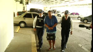 Dr. Arthur Porter is escorted by Panama police officers in this undated image.