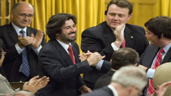FILE- Liberal MP Pablo Rodriguez (centre) stands House of Commons in this February 14, 2007 photo in Ottawa.