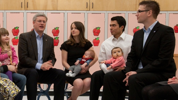 Conservative Leader Stephen Harper talks with Conservative candidate for Edmonton - Strathcona Ryan Hastman (right) and other parents during a roundtable in Beaumont, Alta., Monday, March 28, 2011. (Adrian Wyld / THE CANADIAN PRESS)