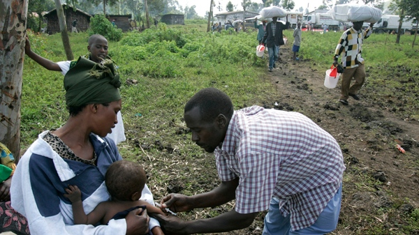 A health worker vaccinates a child against measles in a camp for displaced people in Kibati, north of Goma in eastern Congo on Sunday, Nov. 16, 2008. (AP / Karel Prinsloo)
