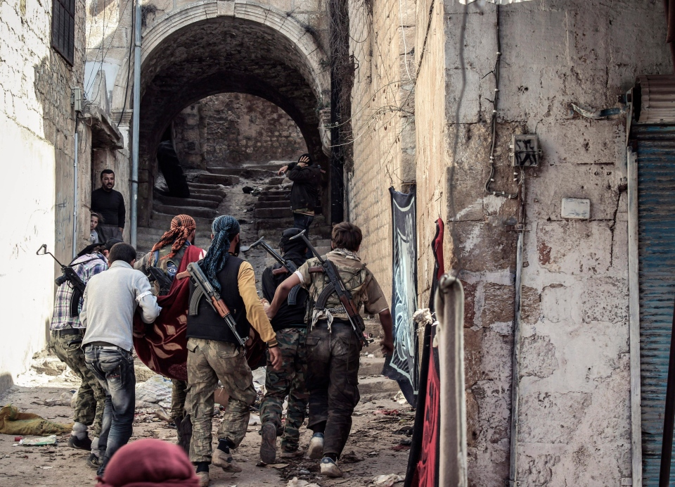 A group of Free Syrian Army fighters are shown in the town of Harem, Syria in this October 2012 file photo. (AP Photo/Mustafa Karali)