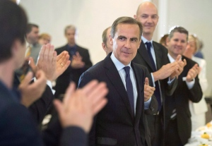 Mark Carney is applauded after delivering his last speech as governor of the Bank of Canada in Montreal on May 21, 2013. (Paul Chiasson / THE CANADIAN PRESS)