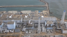 Aerial photo taken by a small unmanned drone, the crippled Fukushima Dai-ichi nuclear power plant are seen in Okumamachi, Fukushima prefecture, northern Japan. From left: Unit 1, partially seen; Unit 2, Unit 3 and Unit 4. (AIR PHOTO SERVICE)