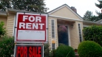 A house with a for rent and for sale sign in front of a home in Portland, Ore., Sept. 13, 2011.  (AP / Rick Bowmer)