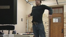Andre Doucette uses his whole body to play the new game Grab Apple, developed at the University of Saskatchewan.