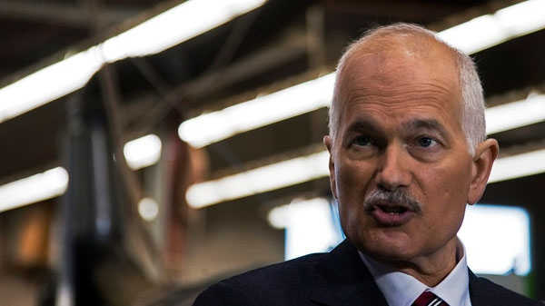 NDP Leader Jack Layton announces plans to assist small business as he visits a wood working plant during a campaign event in Oshawa, Ont. on Wednesday, March 30, 2011. (Andrew Vaughan / THE CANADIAN PRESS)
