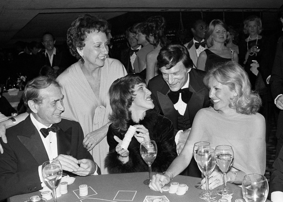 Actress Jean Stapleton, top left, and publisher Hugh Hefner laugh with, from foreground left, Darren McGavin, Ruth Buzzi and Barbara Fisher, during a black-tie casino fund raiser in Los Angeles on Monday, March 13, 1979. (AP / Lennox McLendon)