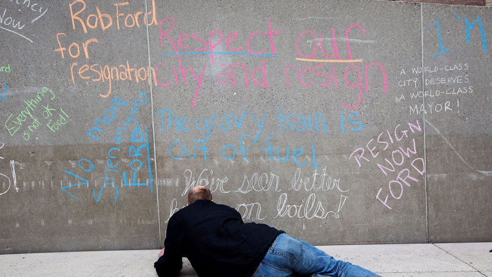 Anti-Rob Ford phrases are drawn in chalk as protestors took to Nathan Phillips Square to call on Mayor Rob Ford to step down in Toronto on Saturday, June 1, 2013. (Michelle Siu / THE CANADIAN PRESS)