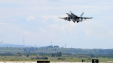 A CF-18 Hornet takes off from Trapani, Italy on Monday, March 21, 2011. (Cpl. Marc-Andre Gaudreault / Department of National Defence)