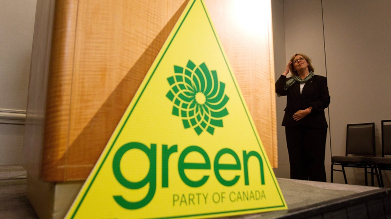 Green Party leader Elizabeth May adjusts her hair as she awaits the start of a news conference in Vancouver, B.C., on Wednesday March 30, 2011. (Darryl Dyck / THE CANADIAN PRESS)
