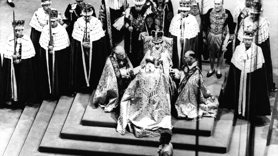 Queen Elizabeth II, seated on the throne, receives the fealty of the Archbishop of Canterbury, back to camera at centre, the Bishop of Durham, left and the Bishop of Bath and Wells, during her coronation in Westminster Abbey, London. (AP)