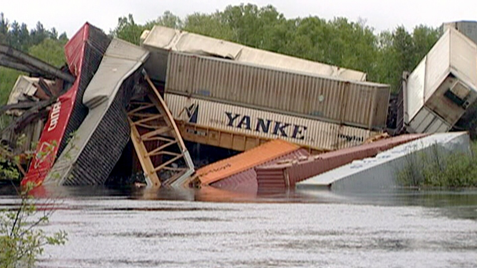 Train cars are piled up in the Wahnapitae River on Sunday, June 2, 2013. (CTV Northern Ontario)
