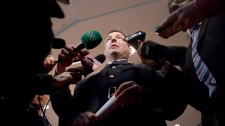 Inspector Keith Finn (right) of the RCMP's  Integrated National Security Enforcement Team (INSET) scrums withe the media following a press conference in Toronto on Thursday March 30, 2011 relating to the arrest of Mohamed Hersi. (Chris Young / THE CANADIAN PRESS)