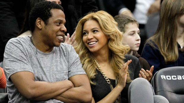 New Jersey Nets' minority owner Jay-Z and Beyonce Knowles sit courtside during an NBA basketball game between the Nets and the Phoenix Suns, Monday, Feb. 28, 2011, in Newark, N.J. (AP / Julio Cortez)