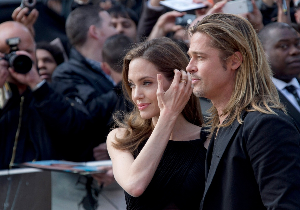 Brad Pitt and Angelina Jolie arrive for the World Premiere of World War Z at a central London cinema on June 2, 2013. (AP Photo/Invision/ Joel Ryan)