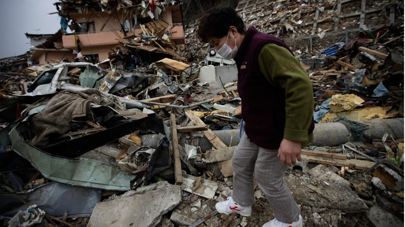 A woman looks for her belongings at the earthquake and tsunami devastated area in Onagawa, Miyagi Prefecture, northern Japan, Thursday, March 31, 2011. (AP / Eugene Hoshiko)