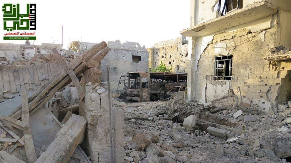 This citizen journalism image provided by the Local Council of Barzeh, which has been authenticated based on its contents and other AP reporting, shows destroyed homes from government airstrikes and shelling, in the Barzeh district of Damascus, Syria, Saturday, June 1, 2013. (Local Council of Barzeh)