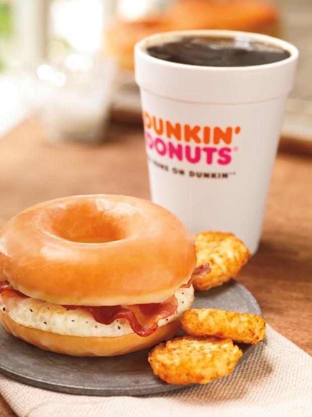 Dunkin' Donuts putting doughnut breakfast sandwich