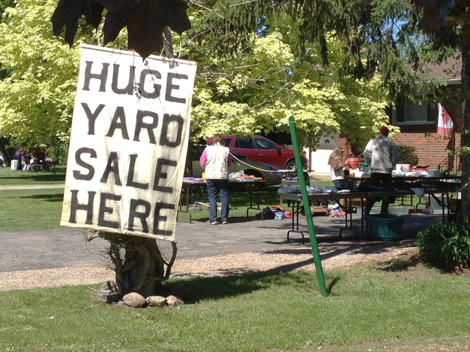Shoppers browse at a community garage sale in New Hamburg, Ont., on Saturday, May 25, 2013. (David Imrie / CTV Kitchener)
