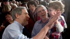 Liberal leader Michael Ignatieff gets a high five from Avie Brodeur at a town hall meeting on a campaign stop in Winnipeg, Wednesday, March 30, 2011. (Ryan Remiorz / THE CANADIAN PRESS)