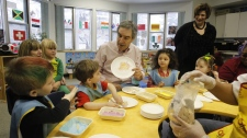 Liberal Leader Michael Ignatieff draws with a child during a campaign stop at Lord Roberts Preschool in Winnipeg on Thursday, March 31, 2011. (THE CANADIAN PRESS/Ryan Remiorz)