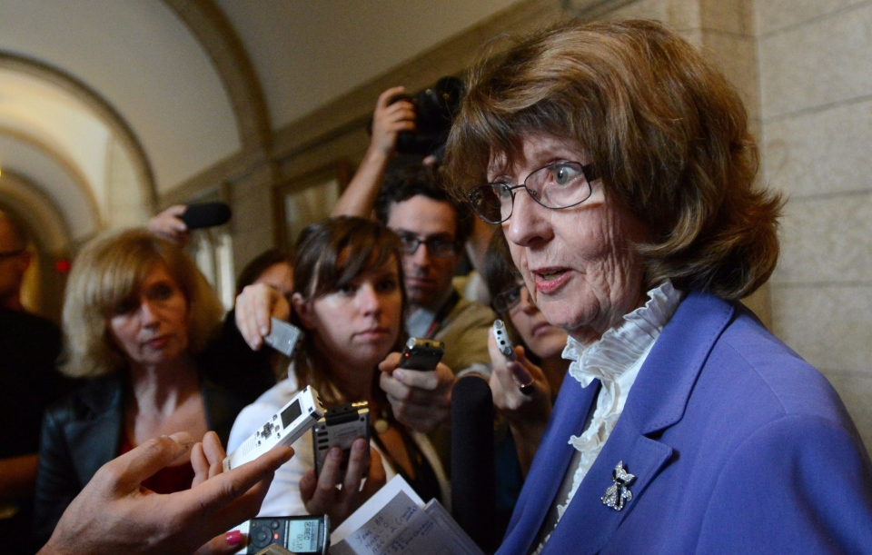 Then-leader of the government in the Senate Marjory LeBreton is questioned by reporters following the Conservative caucus meeting on Parliament Hill in Ottawa on Wednesday, May 29, 2013. (Sean Kilpatrick / THE CANADIAN PRESS)