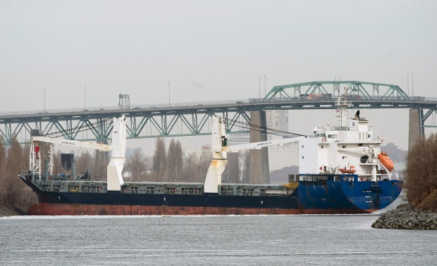 A container vessel identified as the BBC Steinhoeft, is shown after it ran aground in the St. Lawrence seaway between the Jacques Cartier and Victoria bridges in Montreal, Thursday, March 31, 2011.