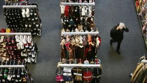 A shopper walks through the aisles of a retail store in this 2008 file photo. (AP Photo/Mark Lennihan)