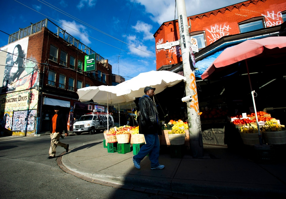 People walk around at Kensington Market in Toronto on Wednesday, Nov. 14, 2012. (Nathan Denette / THE CANADIAN PRESS)