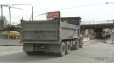 Trucks like this one head up and down Decarie Blvd. all day, kicking up clouds of dust every time.
