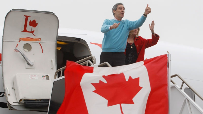Liberal Leader Michael Ignatieff signals thumbs up as he and his wife Zsuzsanna Zsohar board the Liberal campaign plane in Winnipeg, Thursday, March 31, 2011. (Ryan Remiorz / THE CANADIAN PRESS)