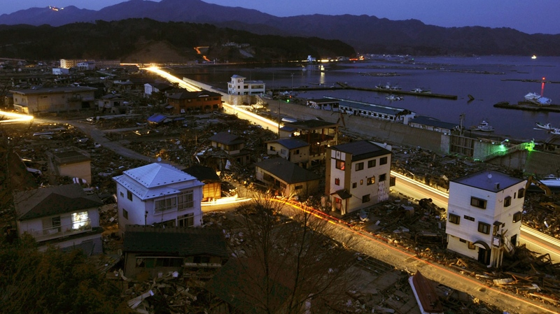 Streams of lights from vehicles are formed in the dimly lit town of Yamada, northeastern Japan on Friday, April 1, 2011. (Kyodo News)