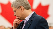 Stephen Harper pauses as he speaks during a visit to a factory in Dieppe, N.B., on Friday April 1, 2011. (Adrian Wyld / THE CANADIAN PRESS)