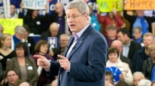 Stephen Harper delivers a speech during a campaign rally in Malpeque, PEI, Friday, April 1, 2011. (Adrian Wyld / THE CANADIAN PRESS)