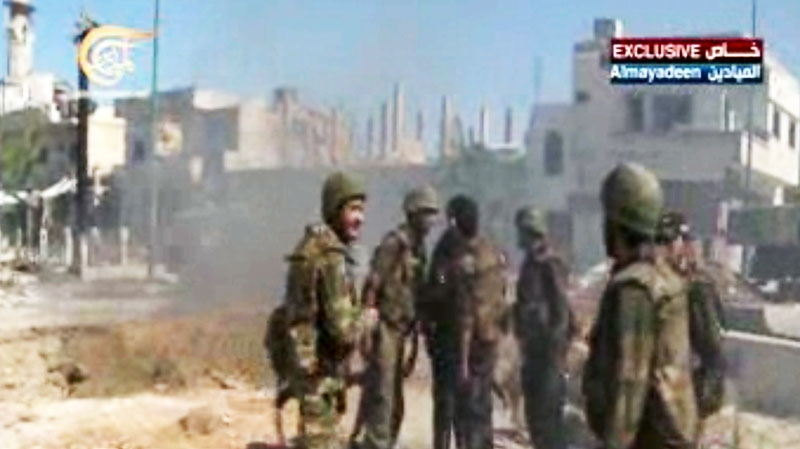 Syrian army troops in Qusair, Syria, Wednesday, June 5, 2013. (Al-Mayadeen Television via AP video)